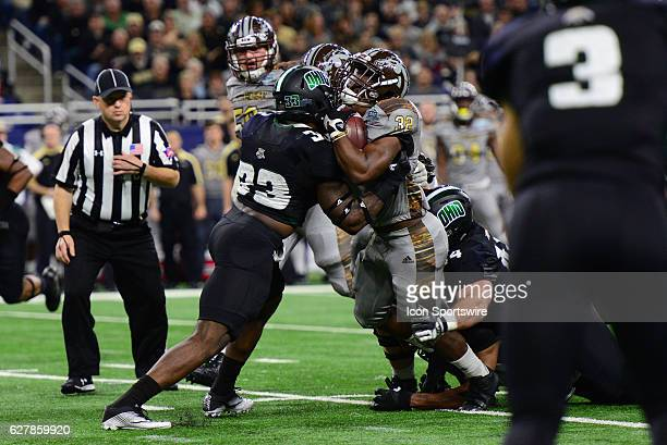 Western Michigan Broncos Running Back Jamauri Bogan is stood up by Ohio Bobcats Linebacker Blair Brown during the MAC Championship game on December 2...
