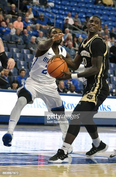 Western Michigan guard Thomas Wilder looks to pass under pressure from Saint Louis guard Aaron Hines during a nonconference basketball game between...