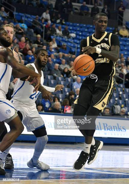 Western Michigan guard Thomas Wilder tries to keep control of the ball during a nonconference basketball game between the Western Michigan Broncos...