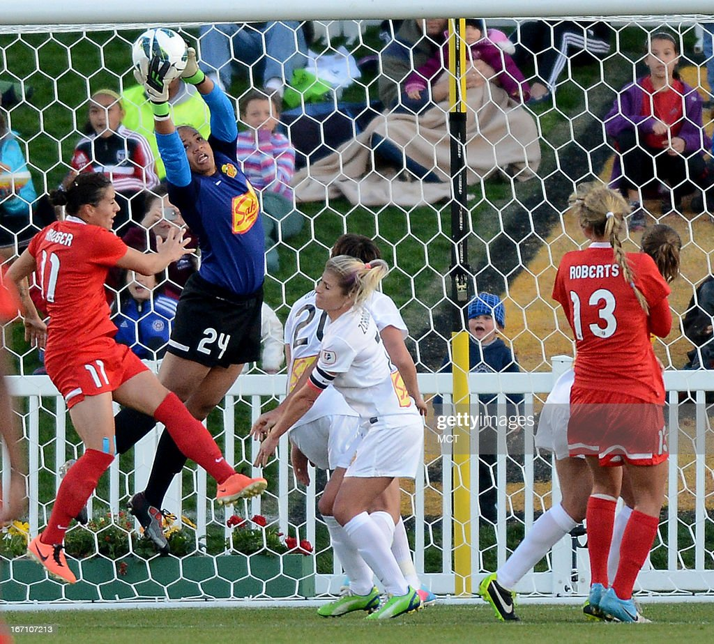 Western NY Flash goalkeeper Adrianna Franch (24) pulls down a Washington Spirit corner kick over Washington Spirit defender Ali Krieger (11) in the first half of an NWSL match at the Maryland SoccerPlex Stadium in Boyds, Maryland, Saturday, April 20, 2013.