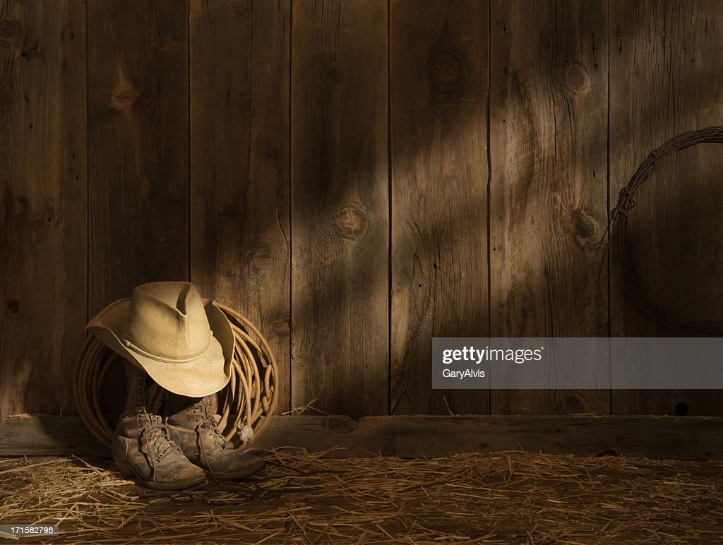 Western packer boots with hat and lasso