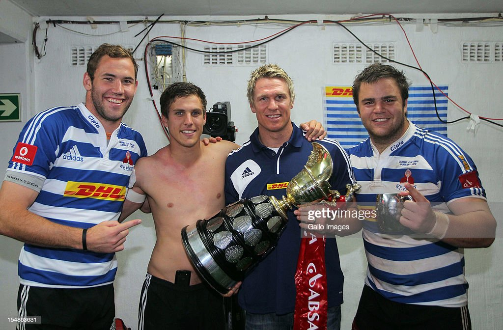 Western Province lock Wilhelm van der Sluys, Louis Schreuder, <a gi-track='captionPersonalityLinkClicked' href=/galleries/search?phrase=Jean+de+Villiers&family=editorial&specificpeople=2285701 ng-click='$event.stopPropagation()'>Jean de Villiers</a> and Western Province prop Frans Malherbe pose with the trophy after winning the Absa Currie Cup final match between The Sharks and DHL Western Province from Mr Price KINGS PARK on October 27, 2012 in Durban, South Africa.
