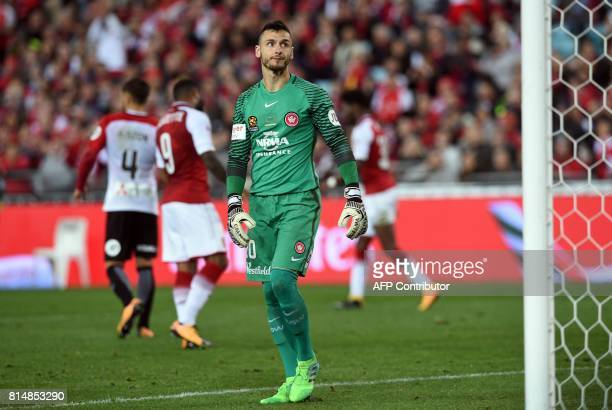 Western Sydney goalkeeper Vedran Janjetovic looks on after a third goal by Arsenal during a friendly game in Sydney on July 15 2017 / AFP PHOTO /...