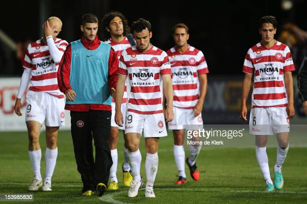Western Sydney players leave the field after the round two ALeague match between Adelaide United and the Western Sydney Wanderers FC at Hindmarsh...