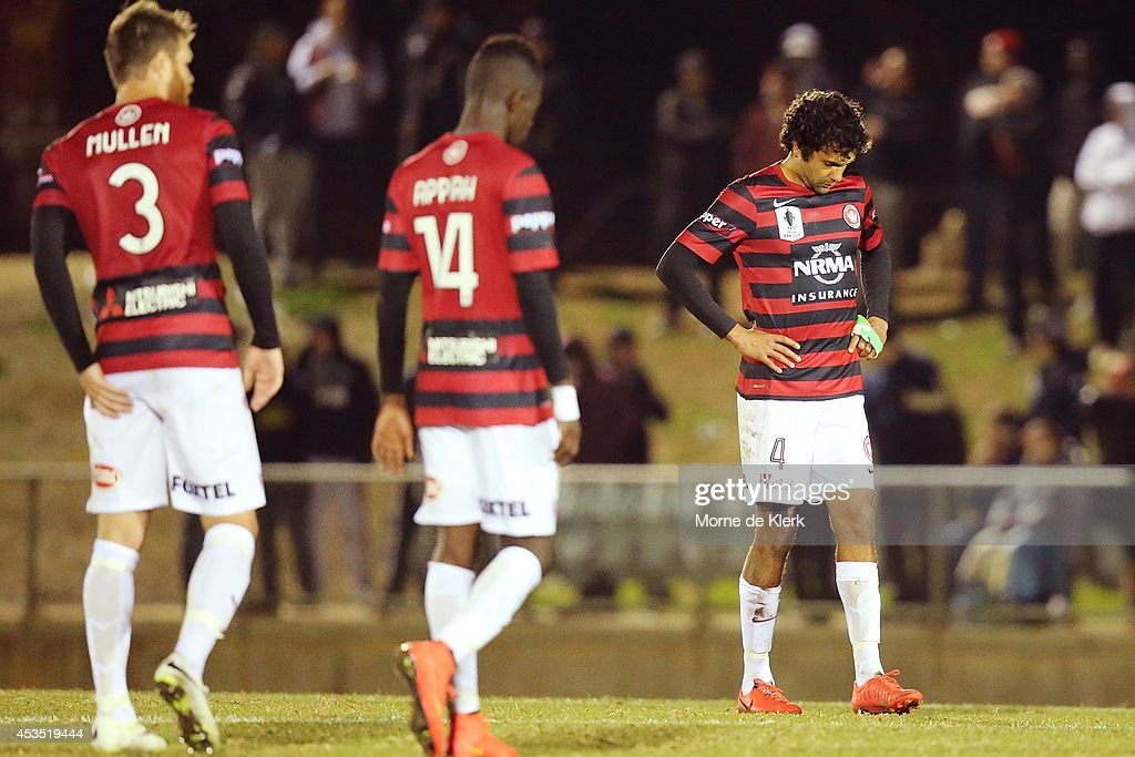 Western Sydney players react after the FFA Cup match between Adelaide City and Western Sydney Wanderers at Marden Sports Complex on August 12, 2014 in Adelaide, Australia.