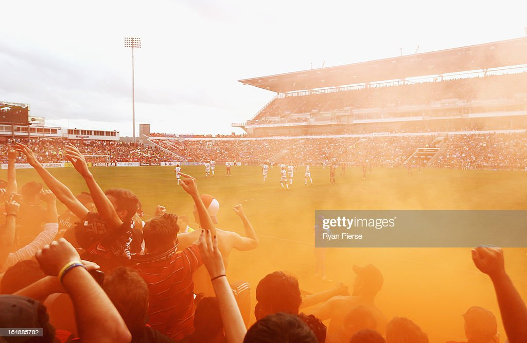 Western Sydney Wanderers fans cheer as a flare is lit during the round 27 A-League match between the Newcastle Jets and Western Sydney at Hunter Stadium on March 29, 2013 in Newcastle, Australia.