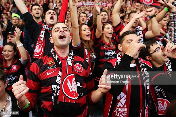 Western Sydney Wanderers fans cheer during the ALeague 2013 Grand Final match between the Western Sydney Wanderers and the Central Coast Mariners at...