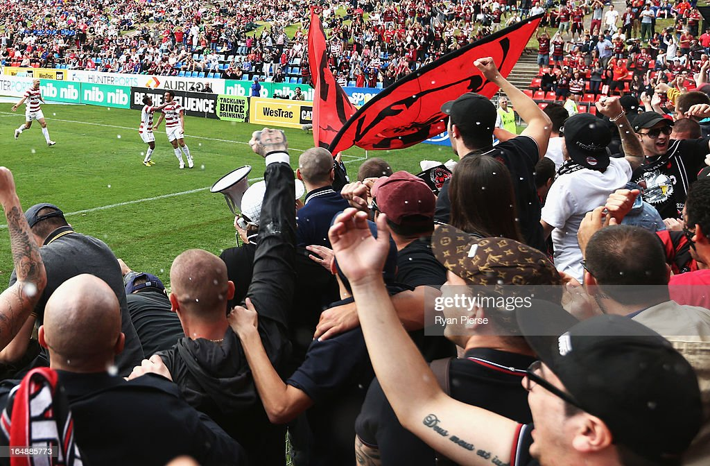 Western Sydney Wanderers fans cheers as <a gi-track='captionPersonalityLinkClicked' href=/galleries/search?phrase=Mark+Bridge&family=editorial&specificpeople=1630520 ng-click='$event.stopPropagation()'>Mark Bridge</a> of the Wanderers scores his team's first goal during the round 27 A-League match between the Newcastle Jets and Western Sydney at Hunter Stadium on March 29, 2013 in Newcastle, Australia.