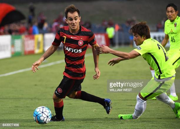 Western Sydney Wanderers player steven Lustica vies for the ball with Urawa Red Diamonds player Ugajin Tomoya during their AFC Champions League...
