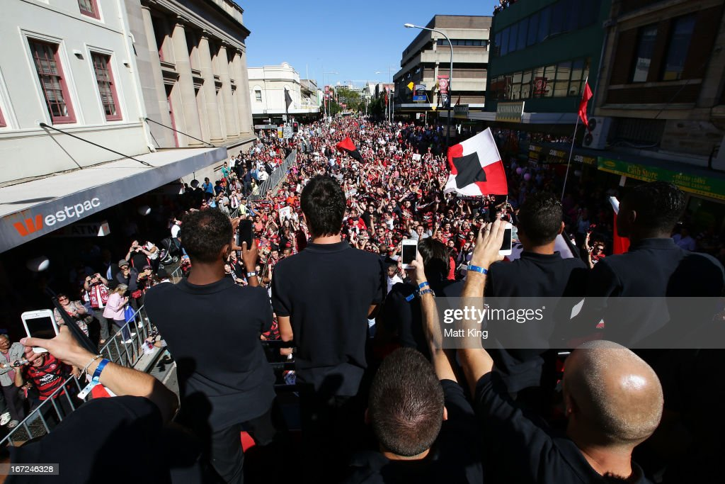 Western Sydney Wanderers players ride on a bus amongst fans during a Western Sydney Wanderers A-League Civic Reception on April 23, 2013 in Parramatta, Australia.