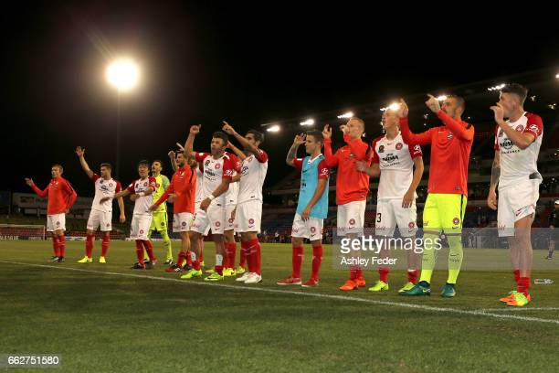 Western Sydney Wanderers team celebrate the win during the round 25 ALeague match between the Newcastle Jets and the Western Sydney Wanderers at...