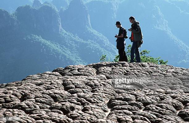 Western tourists at Thousand Turtle Mountain known as Qiangui Shan in Mandarin Chinese outside of Liming in Yunnan Province Popular with Chinese...