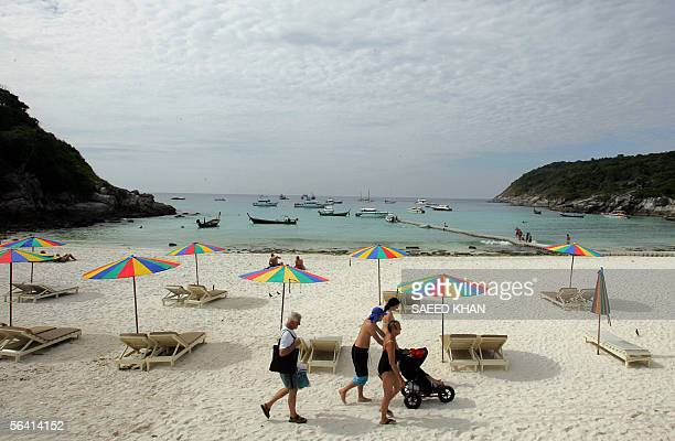Western tourists walk along the shoreline of Koh Raya Island part of Thailand's territory in the Andaman Islands some 23 kilometers from Phuket...