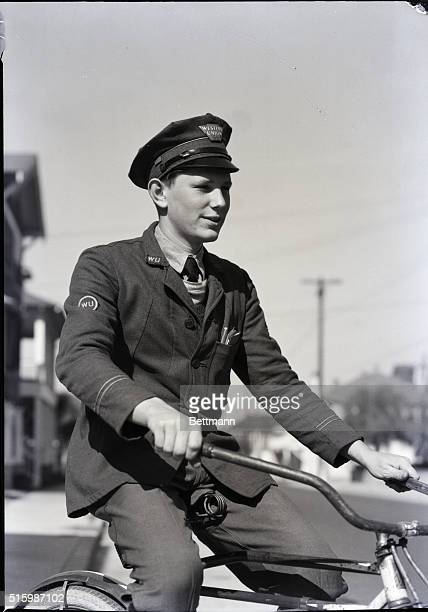 'Western Union' Western Union messenger on his way to make an important delivery by bicycle Undated photograph