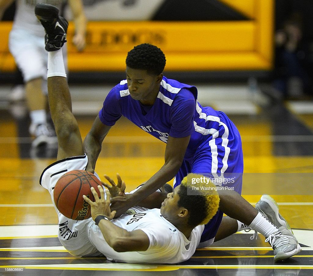 Westfield's Christian Gray, left, and Battlefield's Roman Hall battle for a loose ball as Westfield plays Battlefield in the boys basketball final of the Bulldog Bash at Westfield High School in Chantilly VA, December 29, 2012 .
