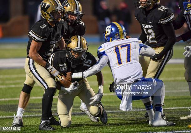 Westfield's Elijah Aikines is helped up by teammates after he recovered an Oscar Smith fumble during the second quarter in the Virginia Class 6 state...