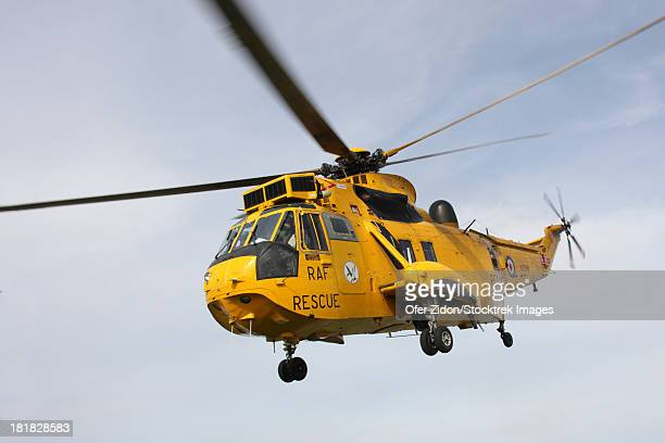A Westland WS-61 Sea King helicopter of the Royal Air Force flying in a rescue mission over Scotland.