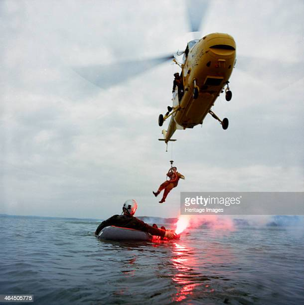Westland Whirlwind helicopter making a rescue 1973 A Westland Whirlwind HAS 10 beloning to RAF Search Rescue lowers a member of the rescue team to...