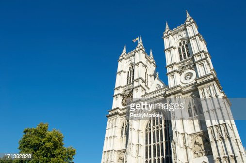 Westminster Abbey London with Bright Blue Sky and Tree