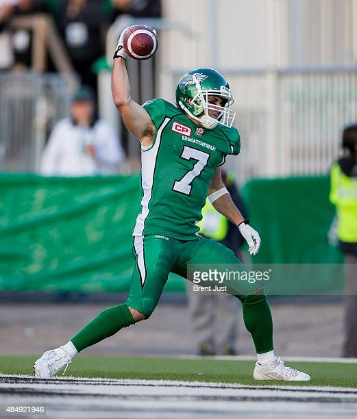 Weston Dressler of the Saskatchewan Roughriders spikes the ball after scoring a touchdown in a game between the Calgary Stampeders and Saskatchewan...