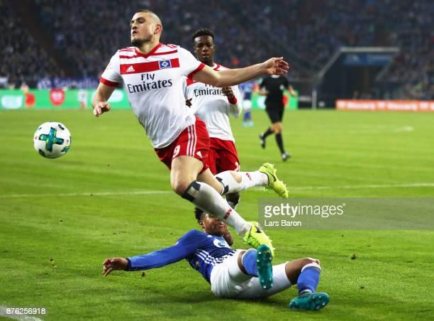 Weston McKennie of Schalke 04 challenges Kyriakos Papadopoulos of Hamburger SV during the Bundesliga match between FC Schalke 04 and Hamburger SV at...