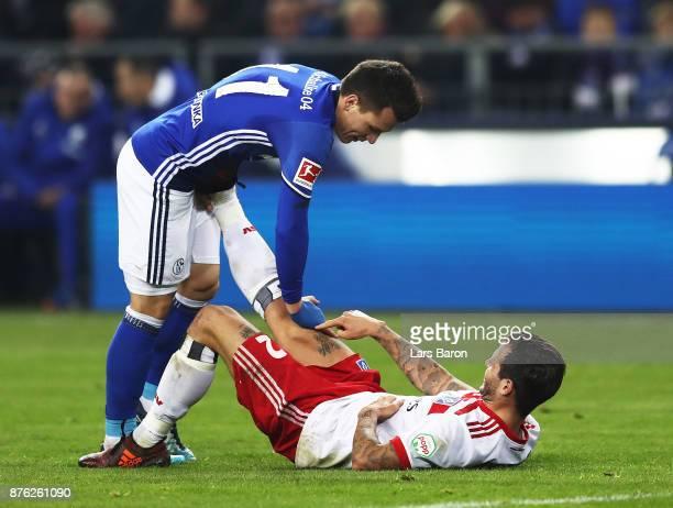 Weston McKennie of Schalke 04 helps stretch Dennis Diekmeier of Hamburger SV during the Bundesliga match between FC Schalke 04 and Hamburger SV at...
