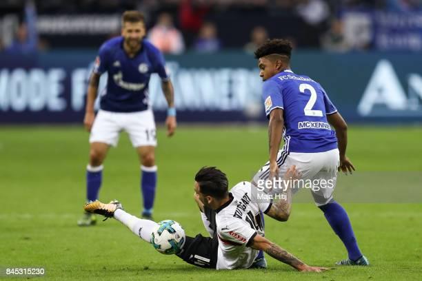 Weston McKennie of Schalke and Anastasios Donis of Stuttgart battle for the ball during the Bundesliga match between FC Schalke 04 and VfB Stuttgart...