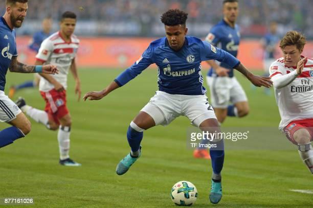 Weston McKennie of Schalke and Gotoku Sakai of Hamburg battle for the ball during the Bundesliga match between FC Schalke 04 and Hamburger SV at...