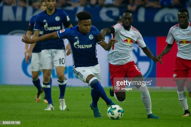 Weston McKennie of Schalke and JeanKevin Augustin of Leipzig battle for the ball during the Bundesliga match between FC Schalke 04 and RB Leipzig at...