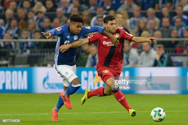 Weston McKennie of Schalke and Kevin Volland of Leverkusen battle for the ball during the Bundesliga match between FC Schalke 04 and Bayer 04...