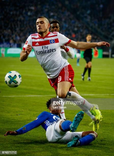 Weston McKennie of Schalke challenges Kyriakos Papadopoulos of Hamburg during the Bundesliga match between FC Schalke 04 and Hamburger SV at...