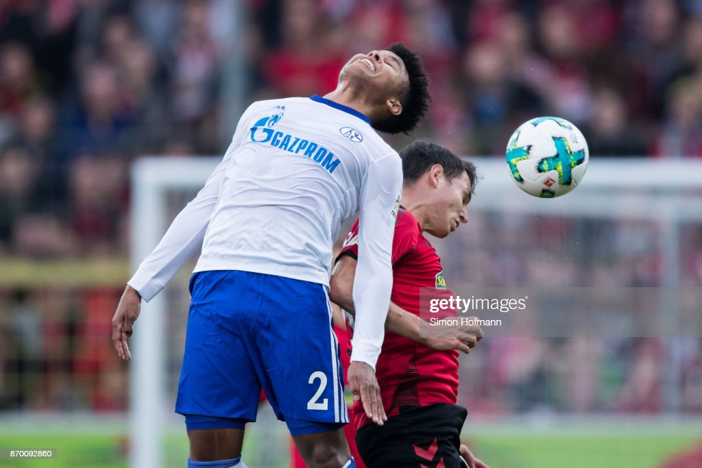 Weston McKennie of Schalke jumps for a header with Nicolas Hoefler of Freiburg during the Bundesliga match between Sport-Club Freiburg and FC Schalke 04 at Schwarzwald-Stadion on November 4, 2017 in Freiburg im Breisgau, Germany.
