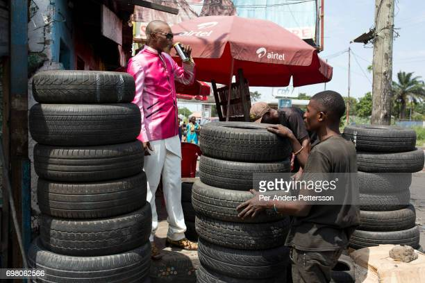 Weston Mwene Kibambe a Sapeur dresses in his favorite suit at at his tire shop on February 11 2017 in Kinshasa DRC The word Sapeur comes from SAPE a...