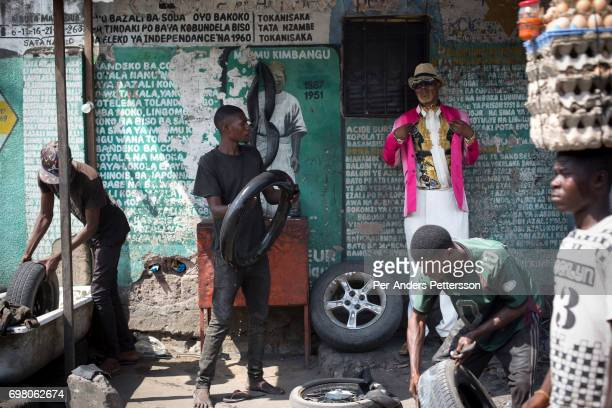 Weston Mwene Kibambe a Sapeur poses for a portrait at his business on February 11 2017 in Kinshasa DRC The word Sapeur comes from SAPE a French...