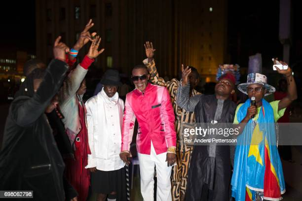 Weston Mwene Kibambe performs outside a hotel with his fellow Sapeurs belonging to a group called Leopards on February 10 2017 in Kinshasa DRC The...