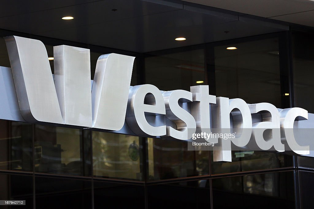 Westpac Banking Corp. signage is displayed above the entrance to Westpac Place, the company's headquarters, in Sydney, Australia, on Friday, May 3, 2013. Westpac, Australia's second-biggest lender by market value, will pay a special dividend for the first time since 1988 after first-half cash earnings rose 10 percent on tighter cost controls. Photographer: Brendon Thorne/Bloomberg via Getty Images