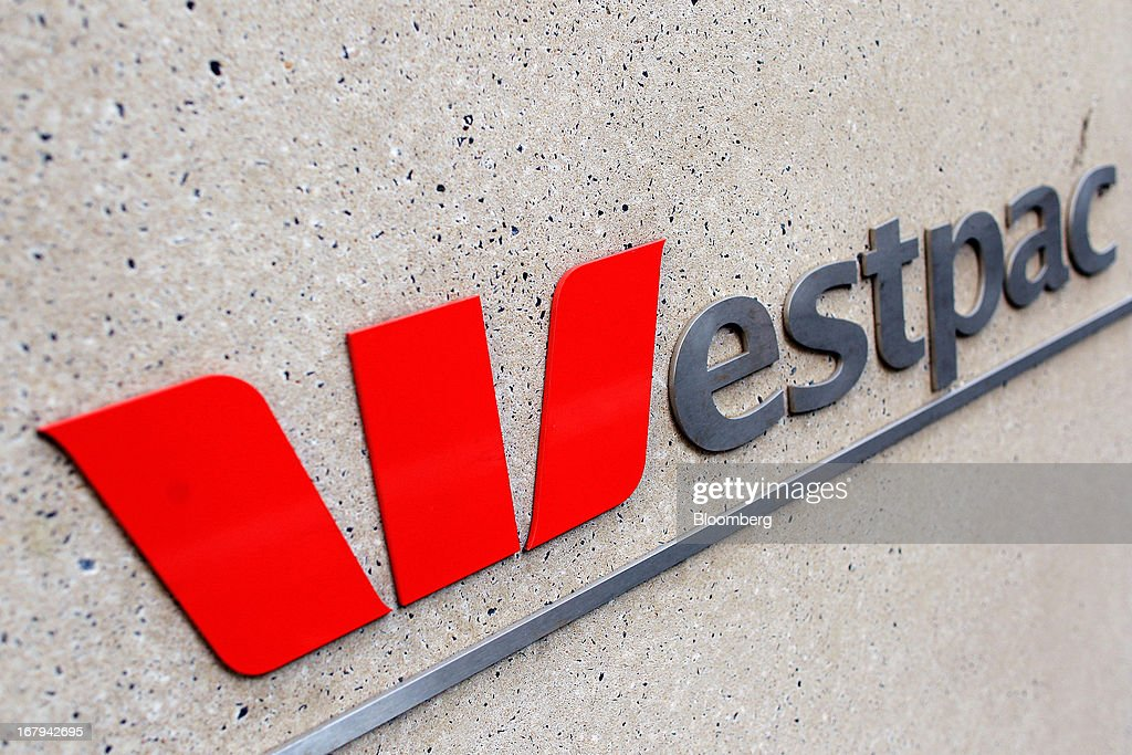 Westpac Banking Corp. signage is displayed at the entrance to Westpac Place, the company's headquarters, in Sydney, Australia, on Friday, May 3, 2013. Westpac, Australia's second-biggest lender by market value, will pay a special dividend for the first time since 1988 after first-half cash earnings rose 10 percent on tighter cost controls. Photographer: Brendon Thorne/Bloomberg via Getty Images