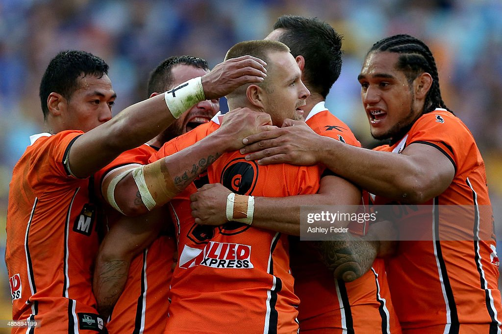 Wests Tigers celebrate a try by Blake Austin during the round seven NRL match between the Parramatta Eels and the Wests Tigers at ANZ Stadium on April 21, 2014 in Sydney, Australia.