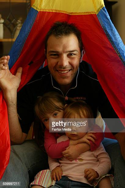 Wests Tigers player John Skandalis with his daughters Olivia and Sophia at their Glen Alpine home 5 May 2006 SHD SPORT Picture by ANTHONY JOHNSON