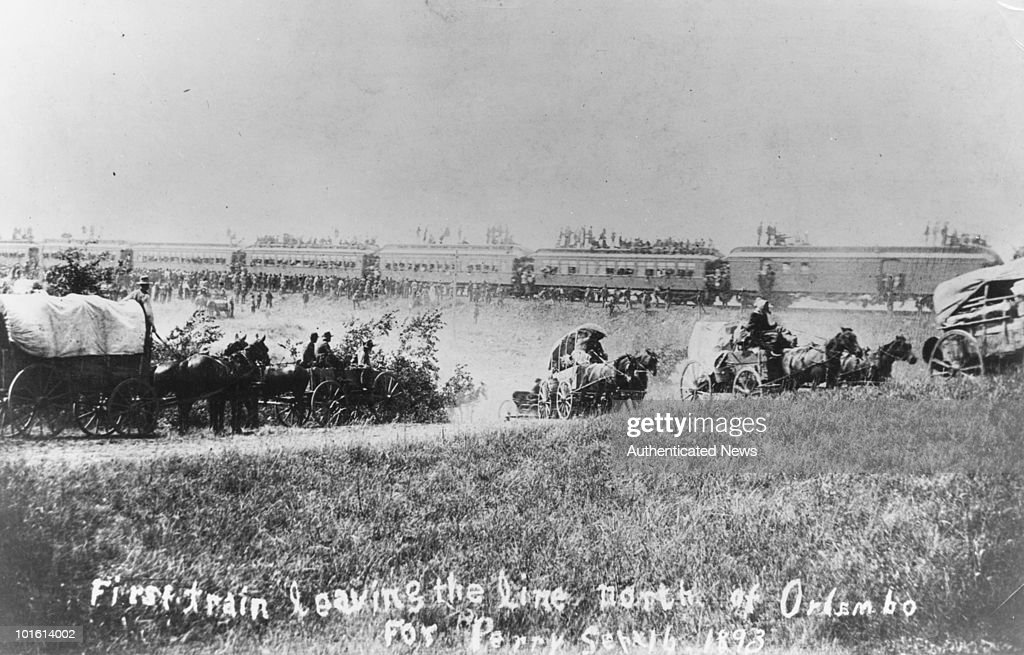American settlers leaving Orlando Oklahoma by wagon and train for Perry 16th September 1893