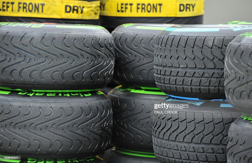 Wet and intermediate tyres are stacked at the back of a garage in the lead up to the Formula One Australian Grand Prix in Melbourne on March 14, 2013. Reigning World Champion Red Bull Driver Sebastien Vettel of Germany was critical of the new season tyres in pre-season practice. IMAGE RESTRICTED TO EDITORIAL USE - STRICTLY NO COMMERCIAL USE AFP PHOTO / Paul CROCK