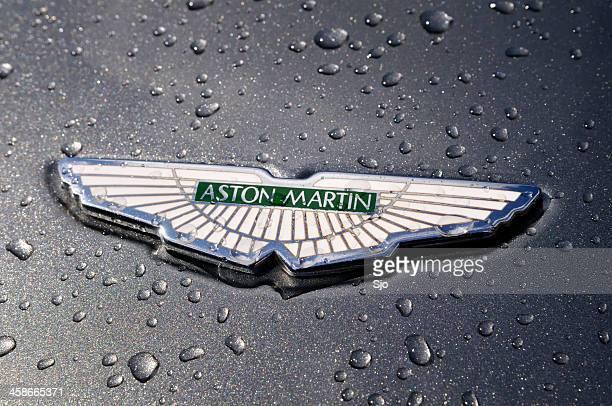 Wet Aston Martin badge on a DB7 sports car