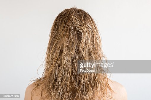 Wet Blonde Messy Womans Hair After Shower On The Gray Background Care About