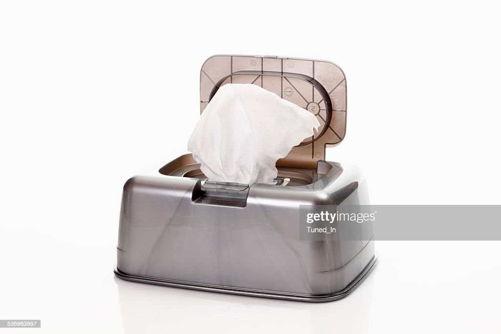 Wet cloth in toaster on white background : Stock Photo
