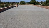 wen concrete is poured on wire mesh steel reinforcement on building