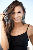 Portrait of a gorgeous young woman gently pulling her wet hairhttp://195.154.178.81/DATA/istock_collage/0/shoots/782260.jpg