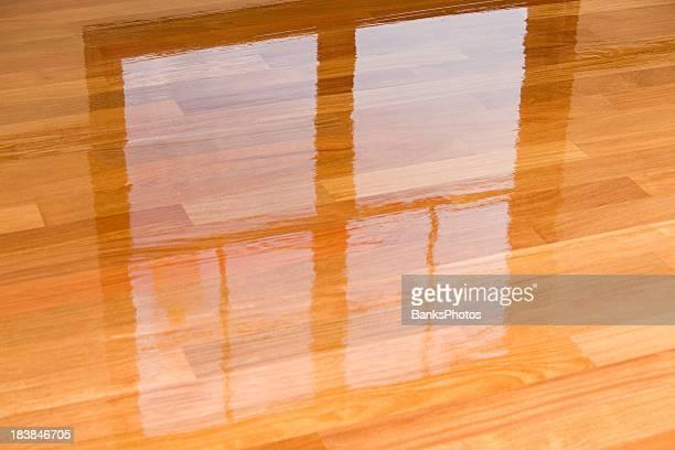Wet Polyurethane on New Hardwood Floor with Window Reflection