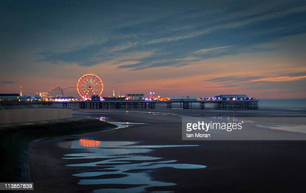 Wet sand and Blackpool central pier