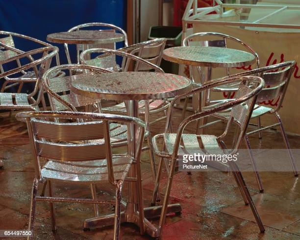 Wet Tables and Chairs at Sidewalk Cafe