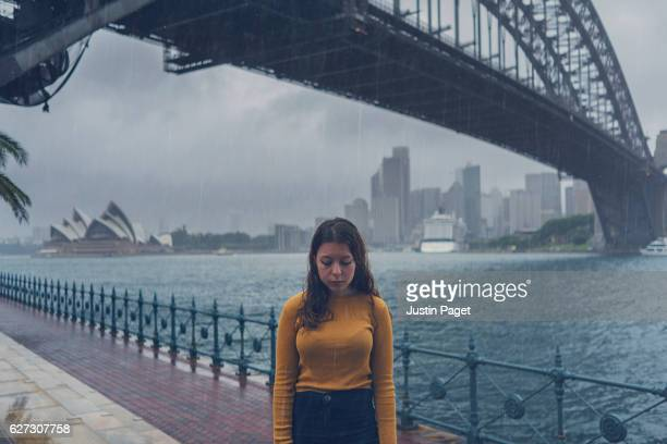 Wet tourist by Sydney Harbour Bridge
